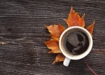 bigstock-coffee-cup-on-the-autumn-fall-38790343-300x215